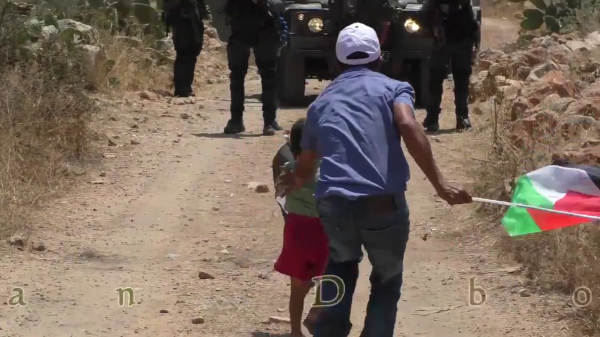 Palestinian child pushed towards soldier video screen shot 2